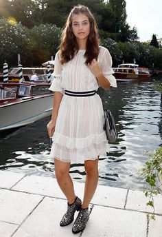 Barbara Palvin dons her prairie dress with a monochrome stripe belt, making it a little smarter in the process. She pairs with cool studded ankle boots (seriously day-to-night appropriate). For a side of chill, simply add a sleek backpack and I'm-naturally-this-pretty hair and make-up