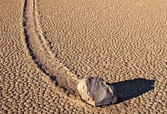 The Racetrack at Death Valley. Large stones move across the sand on their own.  Scientist have yet to understand how or why. A mystery of nature.