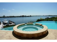 Amazing pool overlooking the bay in this Barefoot Beach home near Naples, FL.