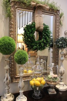 Evergreen spheres on candlesticks; simple wreath hanging from mirror ~ love the way she puts things together - Savvy Seasons by Liz: Spring In My Step.....