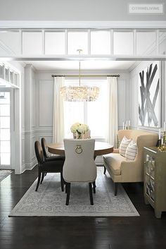 A gorgeous dining room makeover reveal with new gray walls and moldings, painted from the crown to the basboards. A spectacular chandelier sets the tone for this chic, sophisticated, bright and airy look. Dining Room Paint Colors, Dining Room Walls, Dining Room Lighting, Dining Room Design, Dining Room Furniture, Wall Colors, Furniture Sets, Home Design, Design Desk