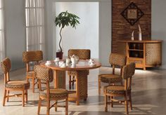 meubles en rotin - table ronde en bois massif, chaises assorties, commode design et cadre décoratif
