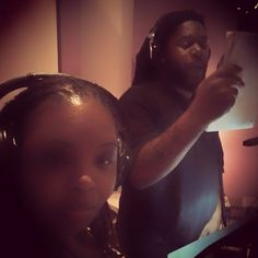 Laying down vocals in the studio with fellow rapper Doe.  Debut album forthcoming soon.