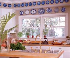 Plate Border - Plates create a lot of color and interest around a window. These blue-and-white plates act like a window valance in a room that needs no other window treatment.