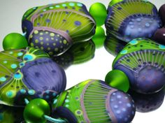 Moogin  lampwork bead set etched emerald and lilac by mooginmindy, £42.00