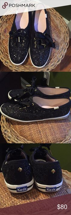 Kate Spade Keds Authentic black glittery Kate Spade Keds. Gently worn. Please see pic #5 where small glitter specs missing on left shoe, but trust me not noticeable when worn! Size 8.5 women's. I bought for my daughter but she doesn't like them 😱 kate spade Shoes Sneakers