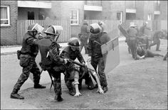 British soldiers drag ringleaders from the rock throwing mob and beat them, Londonderry, 1971, by Ian Berry