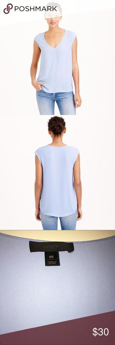 Jcrew cap sleeve shirttail shirt Cap sleeve silly shirt with longer hem. Very flattering and easy to wear. Can be layered or worn alone. Runs large. Polyester- machine wash! In beautiful orchid blue color. In great condition, only worn twice. J. Crew Tops Blouses