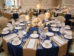 Polished navy blue, gold, and blush wedding reception. Gold napkins, navy tablecloth, and colorful pastel flowers for centerpieces. Mercury gold vases, votives, goblets, and candles surrounded the centerpieces. Reception was held in the Morris Inn at the University of Notre Dame (William and Mary Ann Smith Ballroom).