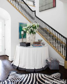 Round table and skirt.Designer Brooke Davenport wanted the entry hall of her Souther California home to make a statement, so she used a graphic zebra rug from Melrose Carpet and a large table skirted with Scalamandre fabric. South Shore Decorating, Foyer Decorating, Decorating Ideas, Decorating Cakes, Decor Ideas, Design Entrée, House Design, Interior Design, Design Ideas