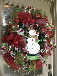 Christmas mesh wreaths.. We could do this with all of the Christmas ribbon we have accumulated over the years!!