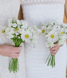 A study in white...white bridesmaid dresses have different textures, white bouquets with different types of white flowers. Floral Design: Fleur de V
