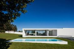 House Touguinhó III is a minimalist residence located in Vila do Conde, Portugal, designed by Raulino Silva Architect Residential Architecture, Contemporary Architecture, Contemporary Design, Minimalist Architecture, Portugal, Modern Bungalow House, House Entrance, White Houses, My House