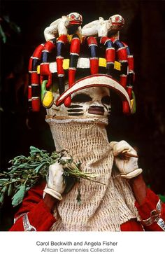 Africa | Oro Efe Mask; symbols of bush hierarchy, the mongoose also from part of the intricate Yoruba tableau of the natural laws of power and social position. Atakora Plateau, Benin. | ©Carol Beckwith and Angela Fisher