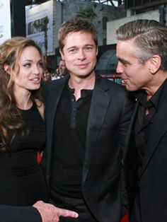 Angelina Jolie, Brad Pitt and George Clooney standing together at a premiere