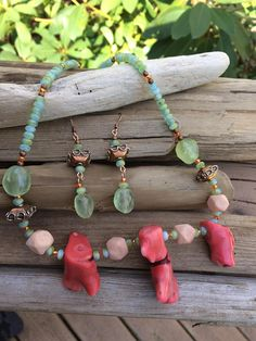 Sea inspired coral statement necklace. set with matching chalcedony and copper earrings. Opal crystals with copper beads, branch coral, chalcedony, and pale coral colored terracotta beads with a copper toggle clasp.
