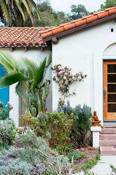 Gorgeous Spanish-style bungalow home with tropical plant landscaping and terracotta tiled roof. Spanish Revival Home, Spanish Style Homes, Spanish House, Spanish Colonial, Bungalows, Spanish Tile Roof, Mission Style Homes, Bungalow Homes, Bungalow Ideas