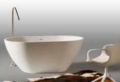Relax and rejuvenate in our designer bath tubs manufactured in different shapes and sizes. Whether you are looking for a traditional built-in bath tub or a classic freestanding bath, we have it all. Ensuite Room, Bathroom Bath, Bathrooms, Bath Tubs, Solid Surface, The Block Room Reveals, Built In Bath, Bathroom Accesories, Stone Bath