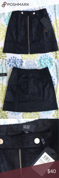 Asos Zip Up Skirt Super cute black faux pony hair a line skirt with a silver zip and popper buttons  Size medium but it runs small. I wouldn't recommend it for a medium at all. It's definitely more of a size small Brand new with tags!  The brand is Goldie but it was bought from Asos Bought for £46 which is about $60 Asos Skirts A-Line or Full