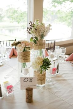 alice brans posted burlap wrapped around glass vases, tied with twine + initialed cork table number holders = perfection to their -wedding ideas- postboard via the Juxtapost bookmarklet. Banquet Decorations, Wedding Table Decorations, Floral Wedding, Wedding Flowers, Cork Table, Late Summer Flowers, Table Number Holders, Rustic Wedding Centerpieces, Summer Centerpieces
