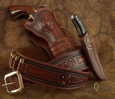 This elegant rig is the perfect choice for your fine sidearm. Made to fit any single six pistol and knife. Price includes 18 loops and shipp... Old West, Custom Leather Holsters, Western Holsters, Cowboy Action Shooting, Pistol Holster, Cowboy Gear, Leather Tooling, Leather Bags, Leather Jewelry