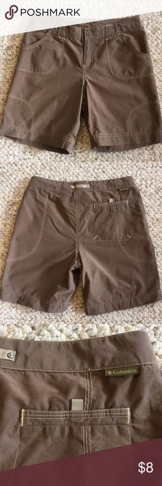 Columbia Kids Shorts Youth size 14 taupe or brown colored shorts, with snap and adjustable waist ribbons threaded through the waistband. 70% cotton 30% nylon, wears like iron! My daughter wore these for several years, and they show no signs of wear. Two front pockets, one back pocket. Columbia Sportswear Bottoms Shorts