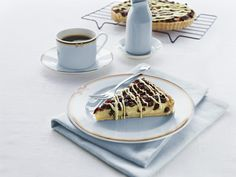 The name frangipane refers to a light and delicious filling made with almonds, coupled with the tang of cranberries and some white chocolate... oh my! #tart #chocolate #desserts To view the #CADBURY product featured in this recipe visit https://www.cadburykitchen.com.au/products/view/cadbury-melts/