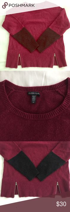 EILEEN FISHER COLORBLOCK SWEATER SPLIT ZIP BOTTOM Comfortable maroon colored sweater with black sleeve details. Split zip bottom detail. Like new condition perfect for fall! Eileen Fisher Sweaters