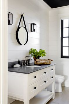 Modern farmhouse bathroom with ship lap walls, white vanity, black counter and natural fiber accents. Rustic Bathroom Vanities, Modern Farmhouse Bathroom, Bathroom Renos, Rustic Farmhouse, Master Bathroom, Bathroom Black, Remodel Bathroom, Shiplap Bathroom, White Bathrooms