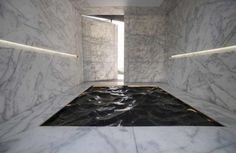 Liquid Marble by Mathieu Lehanneur of France. The project is comprised of a pitch-black marble slab in combination with breaking natural light designed to emulate waves within the water.