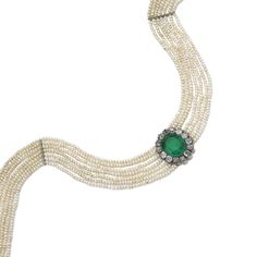 PROPERTY OF A EUROPEAN NOBLE FAMILY: Emerald, seed pearl and diamond choker, late 19th century. The central jewel set with an octagonal step-cut emerald within a frame of cushion-shaped diamonds, on a band composed of seven rows of seed pearls.