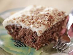 Zucchini Cake recipe from Ree Drummond via Food Network. Made it (without the nuts), very tasty. The icing makes the cake.