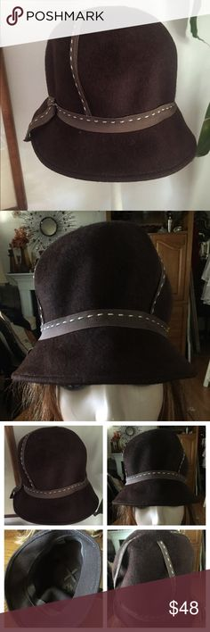 "Vintage Brown Wool Cloche Hat w Ribbon Highlight This awesome vintage NEUMAN ENDLER INC. FAIRFIELD FELTS 100% Wool Cloche Hat is highlighted by brown grosgrain ribbon stitched in white coming from the crown & surrounding the brim. Inside circumference 21-1/2""; crown height  5""; front brim 2""/back 1"". In excellent preowned condition. Smoke-free home. The measurements provided should be compared with your head circumference measurement as the mannequin is a display model only and not…"