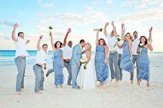 beach wedding, bridal party jumping
