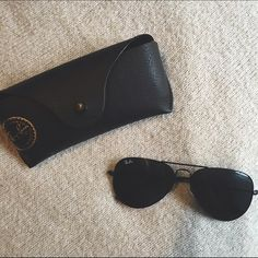 All Black Ray-Ban Aviators All black Ray-Ban aviators. Worn about 5 times. My absolute favorite, but came realize it's a little too small for my face. This is 58mm and 100% authentic. Comes with case, cleaning cloth and the glasses. Ray-Ban Accessories Glasses
