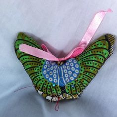 Butterfly needle cushion