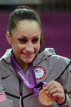 Fresh Faces: U.S. Women Gymnasts - Gymnastics Slideshows | US gymnast Jordyn Wieber celebrates with the gold medal on the podium of the women's team final artistic gymnastics event.   (Photo: Emmanuel Dunand / Getty Images) #NBCOlympics