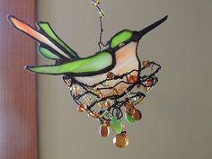 Stained glass nesting hummingbird suncatcher
