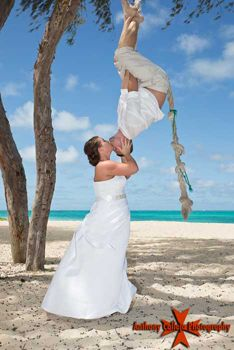 Honolulu Wedding photography spiderman kiss Waimanalo Beach Oahu Hawaii