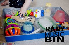 Create a baby music bin to entertain your little one. Using noise makers and homemade rattles, create an auditory sensory experience for baby.