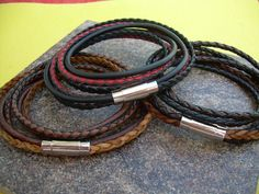 A rich and tasteful double wrap leather bracelet is sure to be one of his favorites.... This bracelet style features 3 strands of Fine Premium Quality - 5mm flat braided and 3mm round and braided leather cords. A secure stainless steel magnetic closure clasp serves as a focal point, ( 21 mm or approx 3/4 inch in length) for easy on and off. All dyes used in our leather are certified 100% Lead-Free and meet all requirements of the German Goods Ordinance, REACH (European Union), RoSH (U.K....