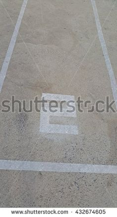 Concrete floor with number two with light and shadow - stock photo