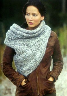 Make your own Katniss Cowl. I bought a large mens sweater yesterday at the second hand store, cut a pattern out of paper, cut out the pieces of sweater and sewed the pieces together to make my own. I love it!