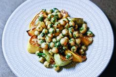 Chickpeas and Roasted Patty Pan Squash.  Made this with roasted squash, bell peppers, and onions.  Only used fresh mint of the herbs.  And used capers instead of anchovies.  Delicious!