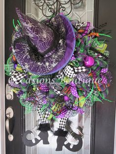 XL Halloween Wreath, Halloween Witch Wreath, Halloween Decoration, Halloween Party Decor, Door Hanger, Front Door Wreath, Witch  This Halloween Wreath is made with layered loops of a shimmering Halloween themed deco mesh, and accented with deco mesh ruffles, high quality wired ribbon, tons of glittered picks and fillers, and a custom made wooden witch legs with boots, and a decorative witch hat. This wreath measures approx. 31 w X 40 H.  This wreath is made to order unless otherwise noted as…