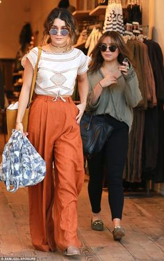 Bonding time: Vanessa Hudgens looked incredible as she enjoyed a shopping trip with her little sister Stella at Free People in Studio City, CA on Monday