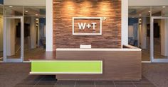 A modern reception desk with a vibrant Chroma accent welcomes visitors to this North Carolina law office.