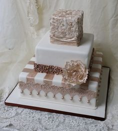Shirred fabric, lace, pearls, peony and painted ribbons.  I loved this cake!
