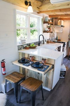 At the end of the kitchen counter is a barstool area with slide out table. #diyhomedecor