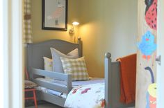 love the seagull print, the little orange chair and all the check fabric. (nine & sixteen blog)